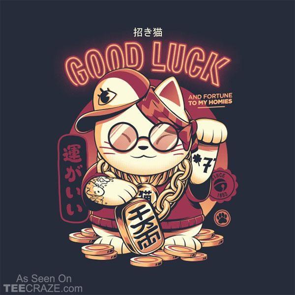 Hình ảnh chú mèo thần tài được sử dụng làm mẫu in áo phông cho dịp năm mới