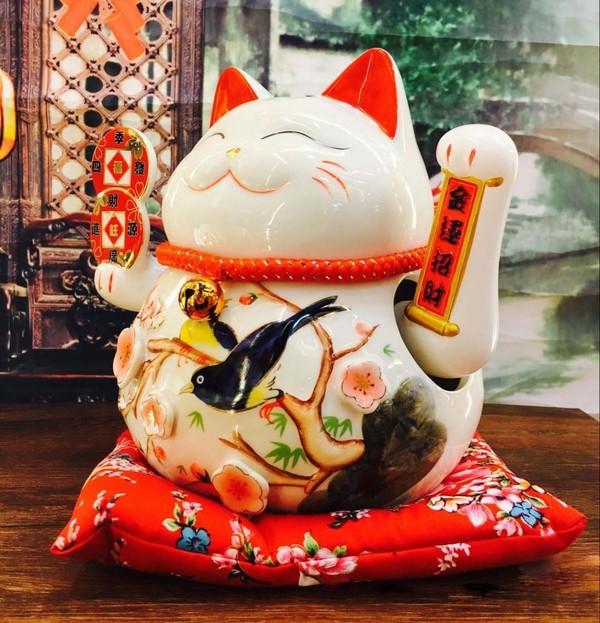 Nếu chưa có điều kiện để mua và chưng mèo thần tài trong nhà, bạn có thể sử dụng những bức ảnh với mong muốn may mắn