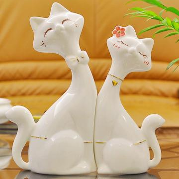Cặp mèo sứ trắng đeo nơ