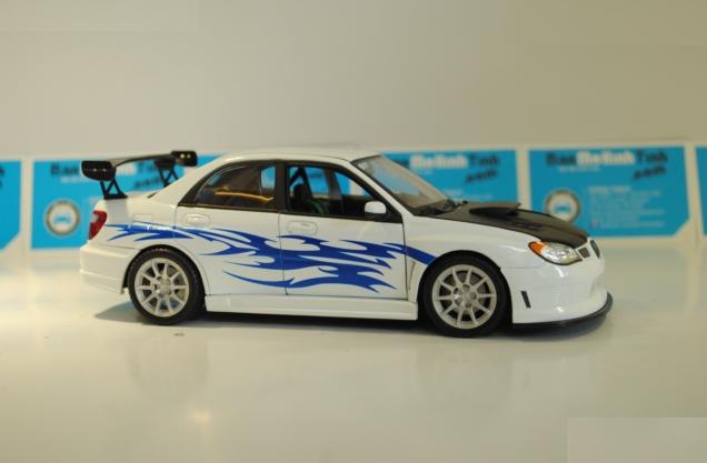 Ô tô mô hình Subaru Impraze màu trắng tỉ lệ 1:24